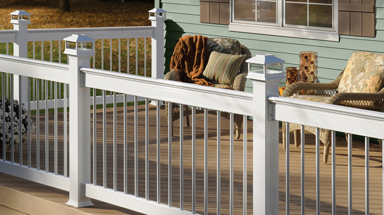 Deckorators ALX Pro Aluminum Railing in White with Round White Balusters and Solar Post Caps