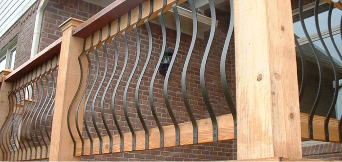 a cedar deck railing with face-mount aluminum balusters in black