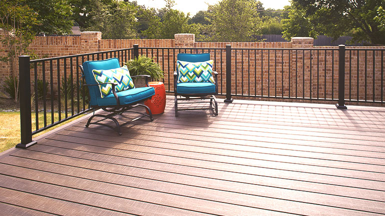 a composite deck with Fortress AL13 Metal railing and bright deck funiture
