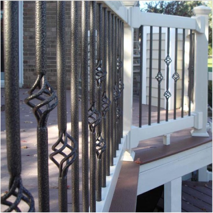 a composite deck railing in white with Fortress basket balusters in Antique Bronze