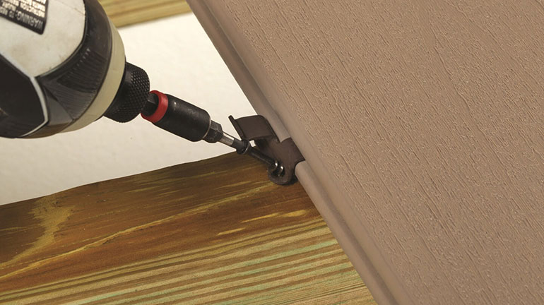 Installation of TimberTech Hidden Fasteners create a fastener-free surface for outdoor decking.