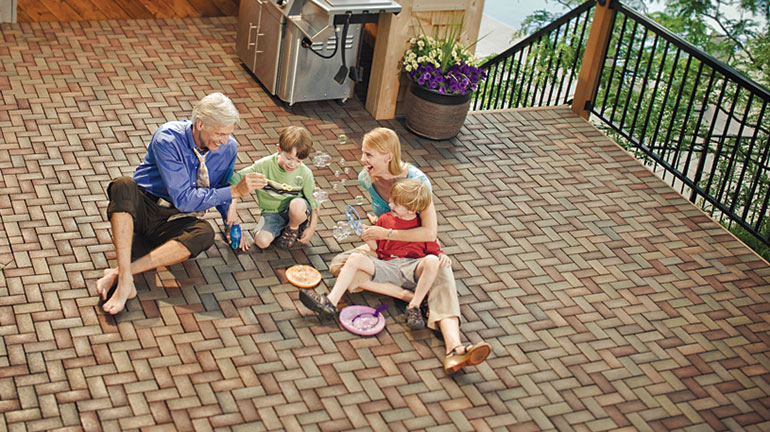 AZEK Pavers resurfaced a deck with a herringbone pattern in a combination of colors: Boardwalk, Village, Olive and Waterwheel