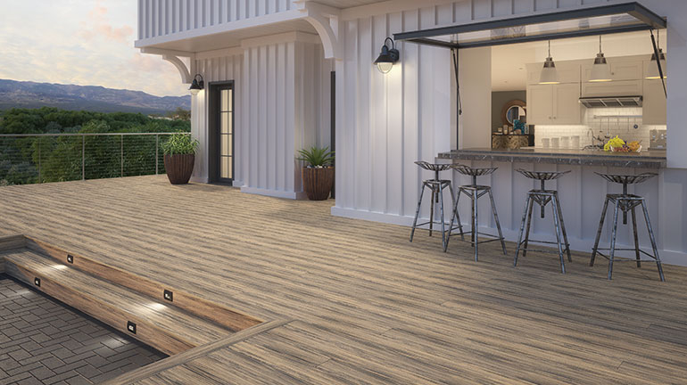 Create your own outdoor kitchen and dining room with the stain-resistant durability of composite decking such as the Deckorators Voyage line in Costa.
