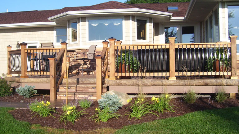Wood deck with Deckorators Arc Architectural Face-Mount balusters