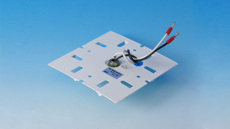 An Electrical Base Plate Socket Converter by Aurora Deck Lighting sits in front of a blue and white background