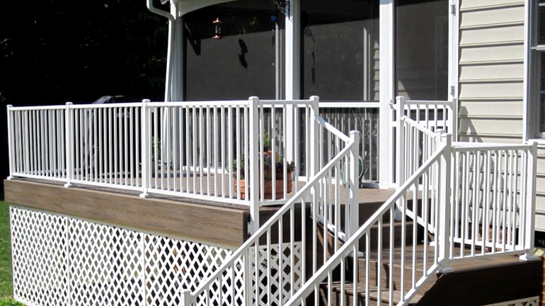 A backyard deck connected to a screen porch is enclosed by Westbury Tuscany Aluminum Railing in White Fine Texture, kinstallation includes surface-mount and fascia-mount posts, plus stair rails