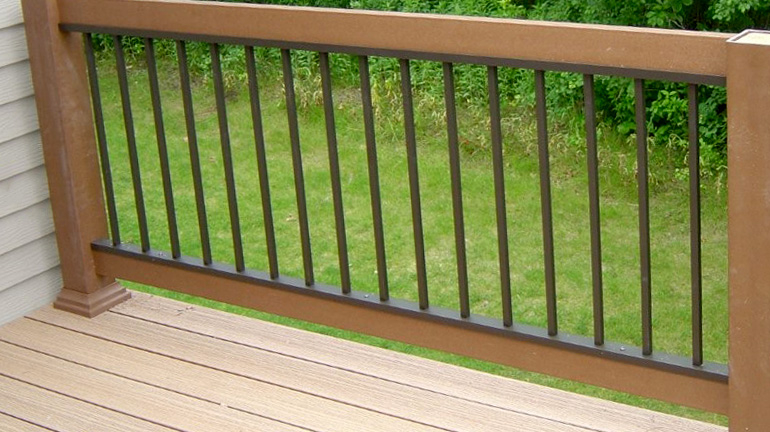 Bronze level Evolve Railing Panel installed between composite rails and posts.