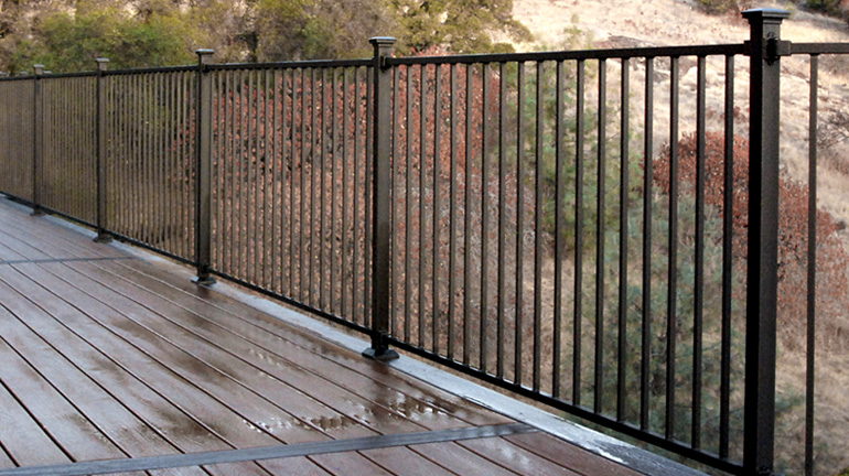 Fortress Fe26 Iron Panel Railing System installed with Collar Brackets and Flat Pyramid Post Caps - Black Sand