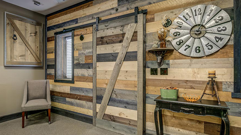 The wall of a home is enhanced with Accent Barn Wood in Mixed Colors.
