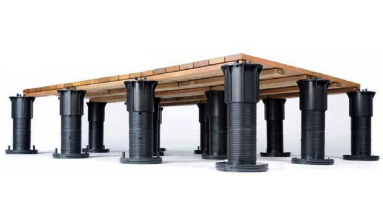 Bison Versadjust pedestals from Bison Deck Supports with couplers are used to support Bison IPE deck tiles