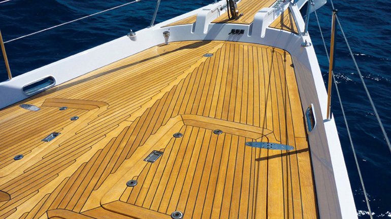 A wood boat deck treated with Penofin Marine Oil shows a lustrous finish and eliminates cracking and peeling.