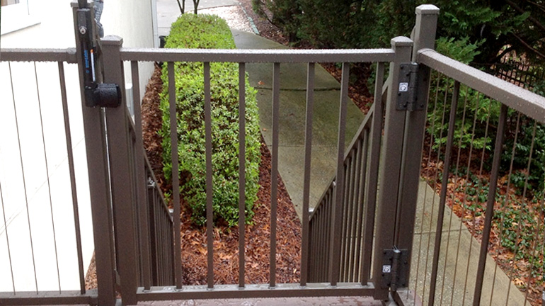 The Bronze Fine Texture Tuscany Adjustable Aluminum Gate by Westbury is installed using Adjustable Self-Closing Gate Hinges and a MagnaLatch Vertical Pull Latch