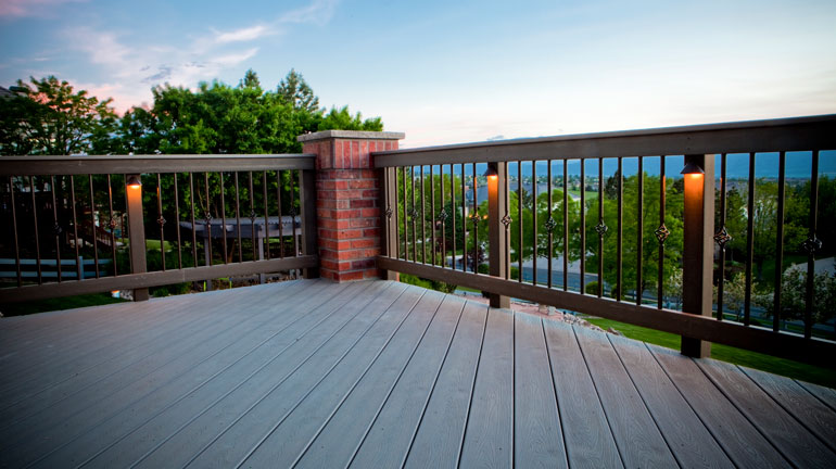 Fortress round basket balusters installed on a roof top deck.