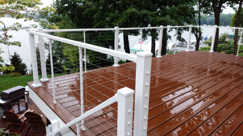 Skyline Railing in White Fine Texture installed on an upper level composite deck overlooking a lake