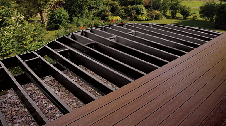 Trex Elevations Steel Framing Joists provide a fireproof, stable foundation for a partially-installed Trex composite deck