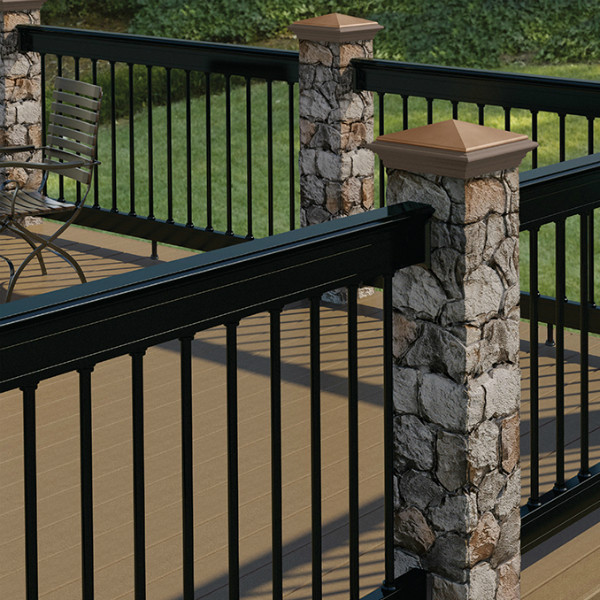 Deckorators Aluminum Cap Rail Kit Installed with ALX Pro Rails, Classic Round Aluminum Balusters, and Stone Post Covers