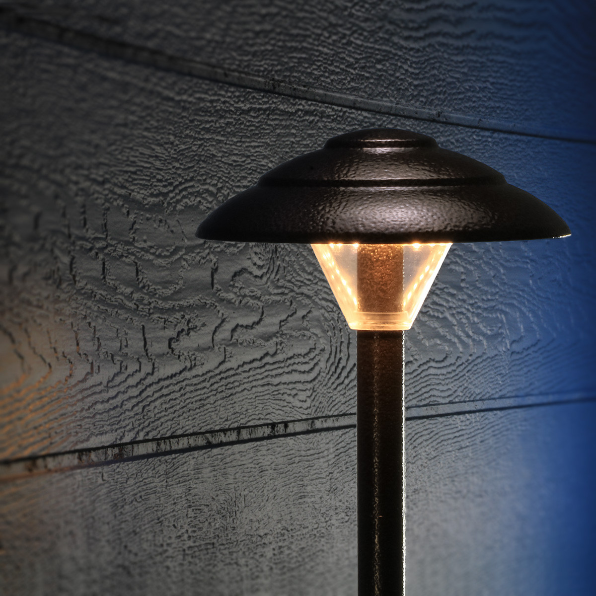 Keep your deck and backyard safe for guests with the Stepped Mushroom Pathway Light by Dekor.