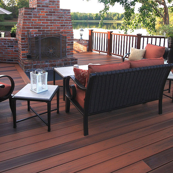 Unify your outdoor space by matching your DuraLife MVP Grooved Edge Deck Boards, shown in Brazilian Cherry, with your furniture.