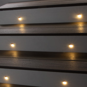 Keep busy walking areas open and clear with the Flush Angled Riser Light brightening the way for family and guests.