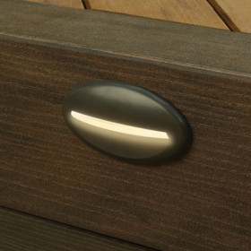 Illuminate your space for safety throughout the night with the TimberTech Riser Light, shown in Architectural Bronze.