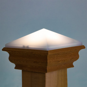 A western red cedar base completes the gorgeous look of the Deckorators Nouveau Corbel Solar Post Cap Light.