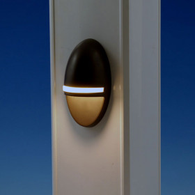 The TimberTech Accent LED Rail Light, shown in Bronze, delivers a stylish touch of art to your deck.
