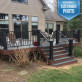 AFCO Aluminum Newel Post Cover Kit installed in textured black with level and stair rails.