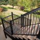 Fortress AL13 Home Stair Rail Brackets, shown in Black Sand, perfectly blend into your AL13 Home deck railing.