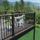 Add a drink rail to the Fortress AL13 Home Level Railing Panel for a large outdoor space perfect for entertaining.