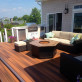 Tie separate pieces of your outdoor space together with multi-tonal DuraLife MVP decking, shown in Brazilian Cherry.