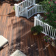 Highlight your white deck railing with a darker shade of DuraLife MVP Grooved Edge decking, shown here in Brazilian Cherry.