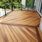 Design a unique decking layout for a space guests will notice with DuraLife MVP Deck Boards in Golden Teak, Brazilian Cherry, and Mahogany.