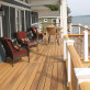 Keep the sun shining year round with stain and fade-resistant DuraLife MVP Deck Boards, shown in Golden Teak.