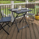 Enjoy dinner al fresco with stain-resistant Trex Enhance here in Coastal Bluff.