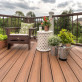 Let your garden grow and shine with Trex Transcend decking in Tiki Torch.