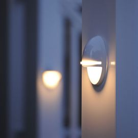 As the sun falls in the sky, the TimberTech Accent LED Rail Light, shown in Gloss White, brightens up your outdoor space.