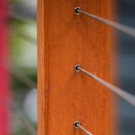 The RailEasy™ Cable Sleeve, shown in the beveled design, will reduce friction between your cable and wood, vinyl or composite posts.