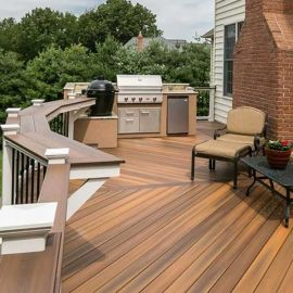 Warm, variegated coloring helps the Fiberon Concordia line of composite decking, shown in Ipe, bring beauty to your backyard.