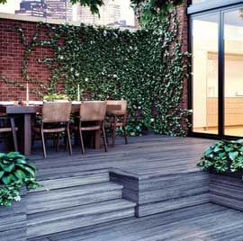 Blend the different levels of your deck together smoothly with Deckorators Vista decking and Vista Fascia; shown here in Driftwood.