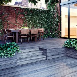 Highlight your multi-level outdoor space with Deckorators Vista Riser Boards, shown in Driftwood.