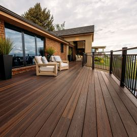 Envision Distinction Collection Decking, shown in Rustic Walnut, provides a low-maintenance outdoor space.