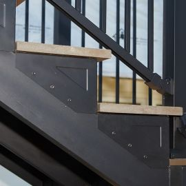 Create a clean-looking outdoor staircase for your deck and porch space with Fortress Evolution Steel Framing system.
