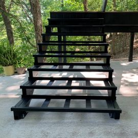 Simply mount and attach the Fortress Evolution Steel Stair Tray to your stair stringer boards for an easy build.