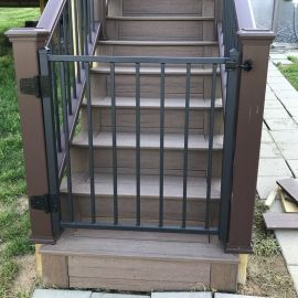 Our customer, Jason L. of Kentucky, installed their FE26 Prefabricated Gate, featured in Black Sand, at the bottom of deck stairs.