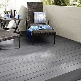Bring your home's living room outdoors with the cool, relaxing feel of embossed Fiberon Good Life composite decking, shown in Beach House.