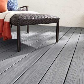 The rich shade of Beach House in the Fiberon Good Life composite decking line creates a backyard oasis.