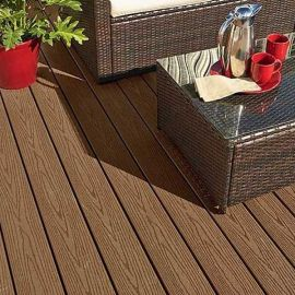 With variating wood-grain textures, the Fiberon Good Life composite deck boards, shown in Cabin, deliver an organic look.