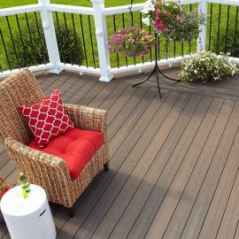 The warm and relaxed shade of Latte in the Fiberon Sanctuary composite deck line provides a beautiful look for your backyard.