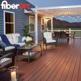 The Fiberon Concordia composite decking collection, shown in Cinnabar, creates a warm outdoor living room for your home.