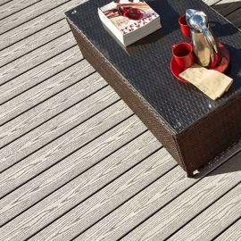Casual and comfortable, the Fiberon Good Life composite decking line, shown in Cabin, creates a safe family space.